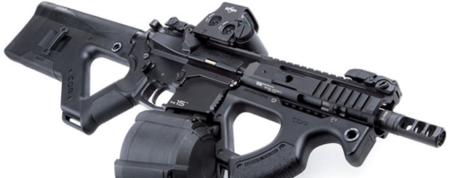 Here an AR-15 has HERA buttstock, foregrip, and an EOTech sight, with Magpul D-60 magazine.