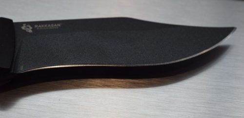 The Rakkasans SK5 steel blade looks sharp, is strong, and will remain sharp.