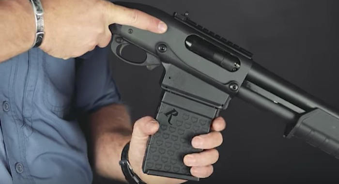 Inserting a magazine into the Remington 870 DM