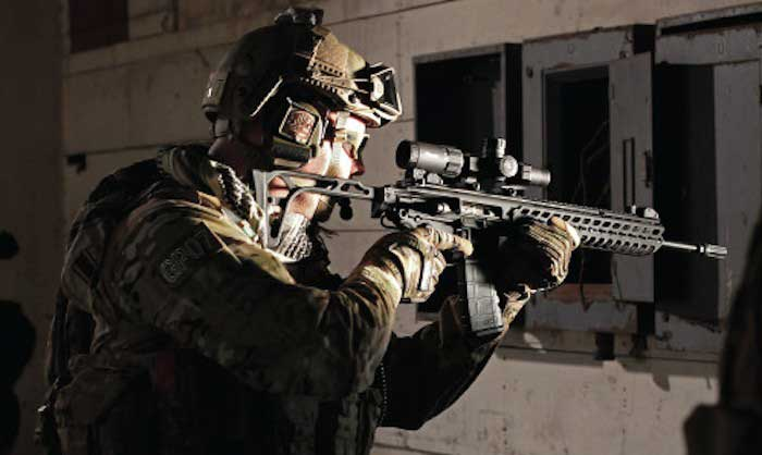 Soldier shooting 1-4x24 scope